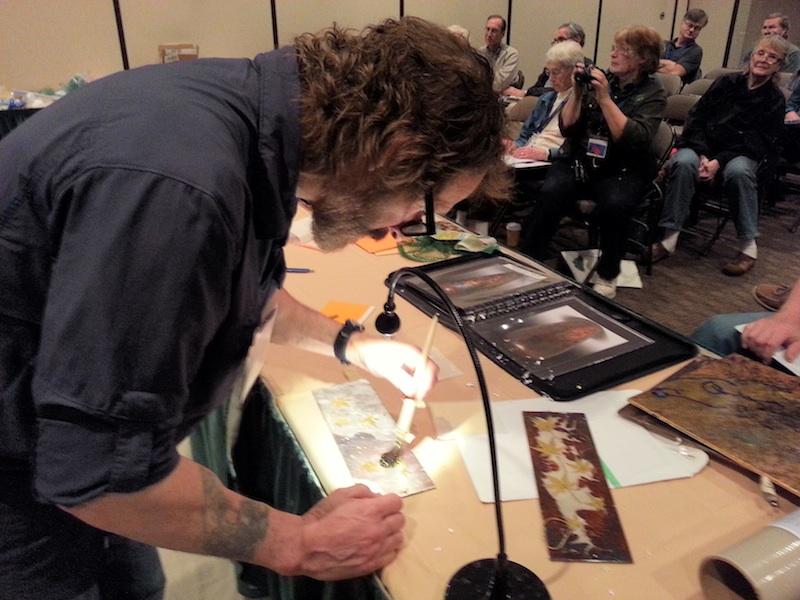 David Marks demonstrates gilding Japanese maple leaves with 22 Karat Gold against a silver leaf background