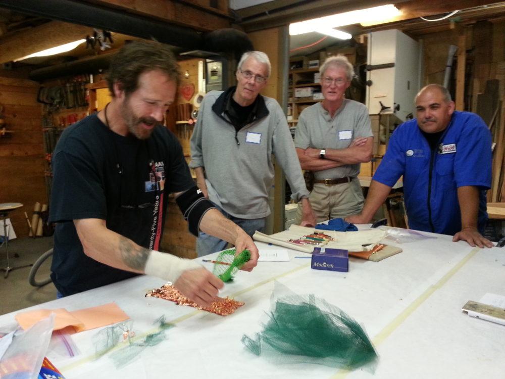 David demonstrating the application of metal leaf using resist material.