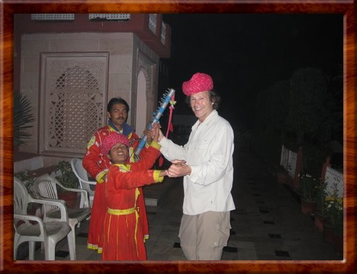 019 Young Bernado invites David to wear Mookesh's hat and dance outside an Indian resturant in Agra