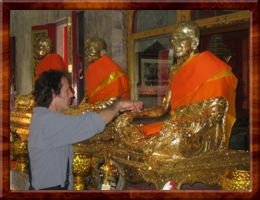 027 David burnishing gold leaf onto one of the bronze statues of three revered Buddhist Monks in Thailand