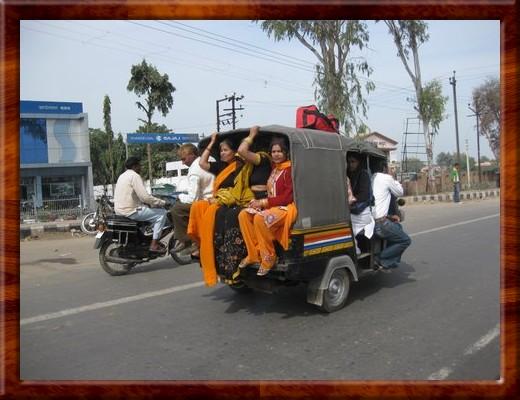 031 Women in back of auto rickshaw in Agra, India