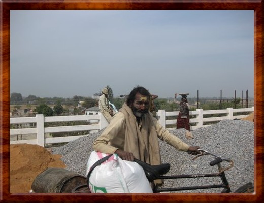 032 Man with bike in Agra, India