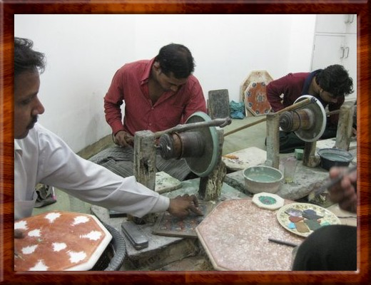 039 Inlay artist in Agra uses a stick to power an abrasive grinding wheel to shape the stones to fit the recess