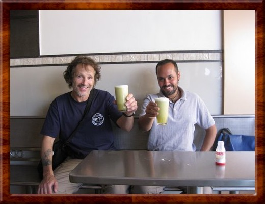 047 David and Abir enjoy a refreshing drink of freshly crushed, sugar cane juice in Pune, India